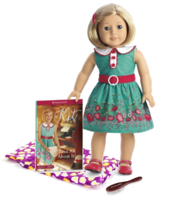 doll with book, sleeping bag and brush