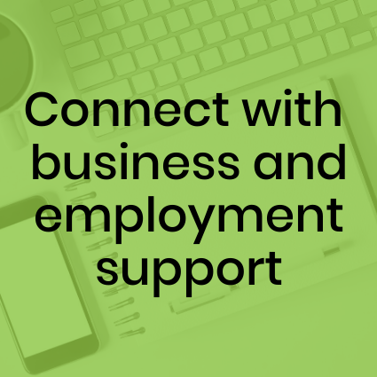Connect with business and employment support. Computer keyboard, notebook, and phone in background.