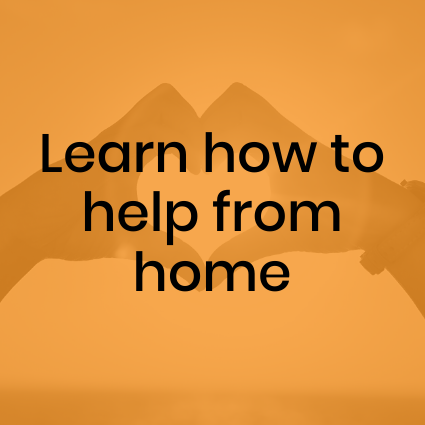Learn how to help from home. Hands making heart shape in background.